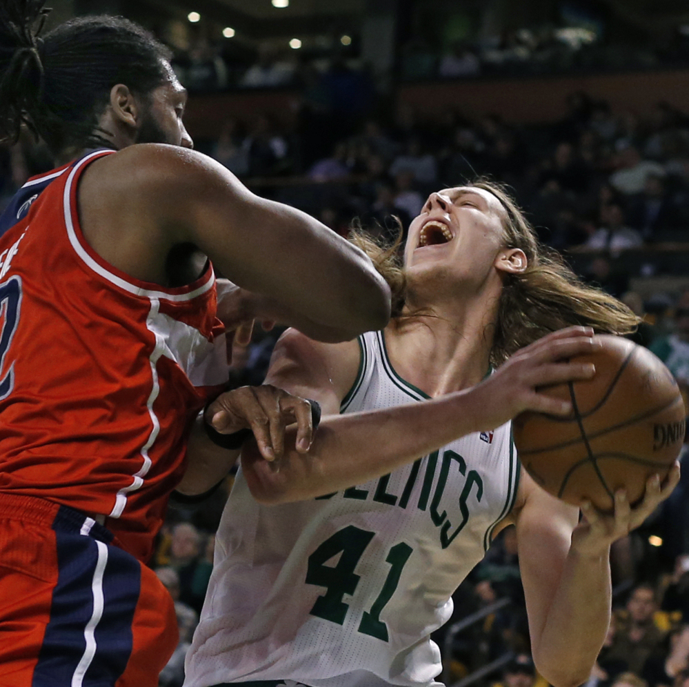 Celtics rookie center Kelly Olynyk goes up to shoot against Washington's Nene Hilario in Wednesday's game at Boston. The Celtics finished the season 25-57.