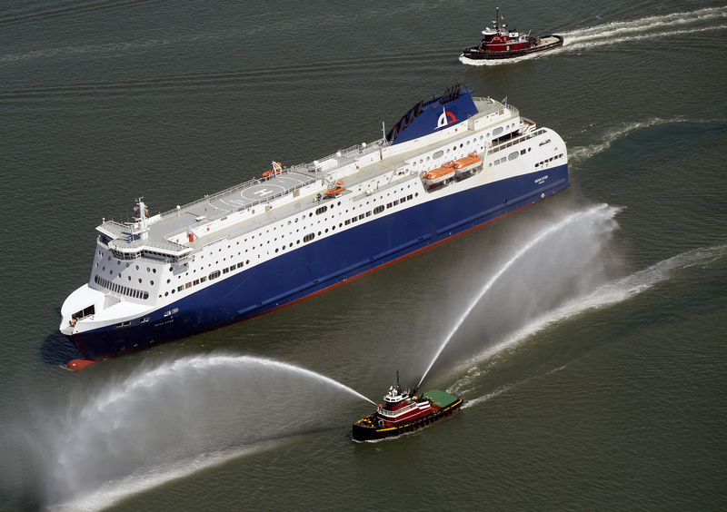 A tugboat gushes dual fountains of water in greeting as the Nova Star ferry cruises into Portland Harbor on Thursday. The ferry will be christened in Boston on May 12.