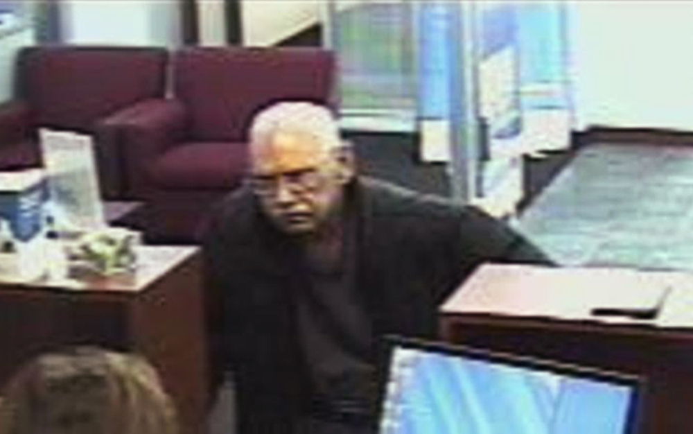 A surveillance photo provided by the FBI shows 73-year-old Walter Unbehaun, an ex-convict from Rock Hill., S.C., during a bank robbery in Niles, Ill., on Feb. 9, 2013.