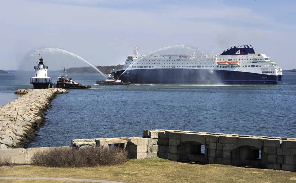 The 530-foot-long Nova Star ferry receives sprays of welcome as it passes Spring Point Light in South Portland on its way to Portland Harbor.