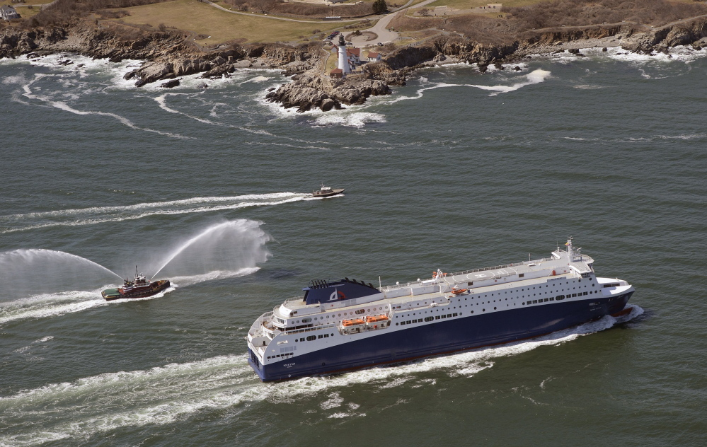 The Nova Star ferry passes Portland Head Light as it enters the channel leading to Portland Harbor on Thursday. While it's docked in Portland, the vessel will be fitted with casino games and other equipment before its maiden voyage with paying customers on May 15.