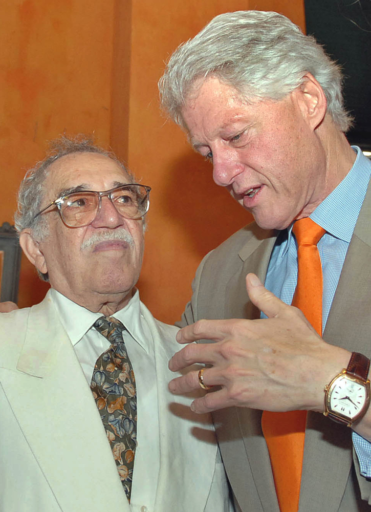 In this March 26, 2007 file photo released by Colombia's News Service SNE, former U.S. President Bill Clinton, right, speaks with Colombian Nobel laureate Gabriel Garcia Marquez at the opening ceremony of International Congress of Spanish Language in Cartagena, Colombia.