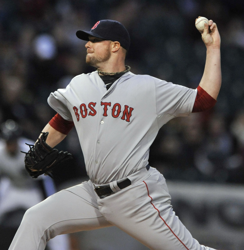 Boston Red Sox starter Jon Lester delivers a pitch in the first inning against the Chicago White Sox in Chicago on Thursday.