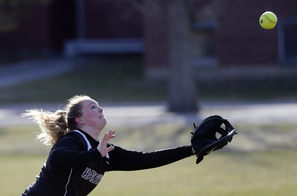 Courtney Taylor, a Marshwood oufielder, chases down a foul ball. Thursday was the opening day for spring high school sports throughout the state.