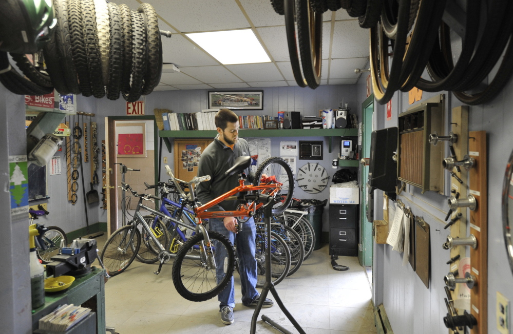 Andrew Burnell works on a bike at the Community Bicycle Center on Hill Street in Biddeford. The program has served more than 1,100 kids since it started eight years ago. Its new location will accommodate more participants and expanded programming.