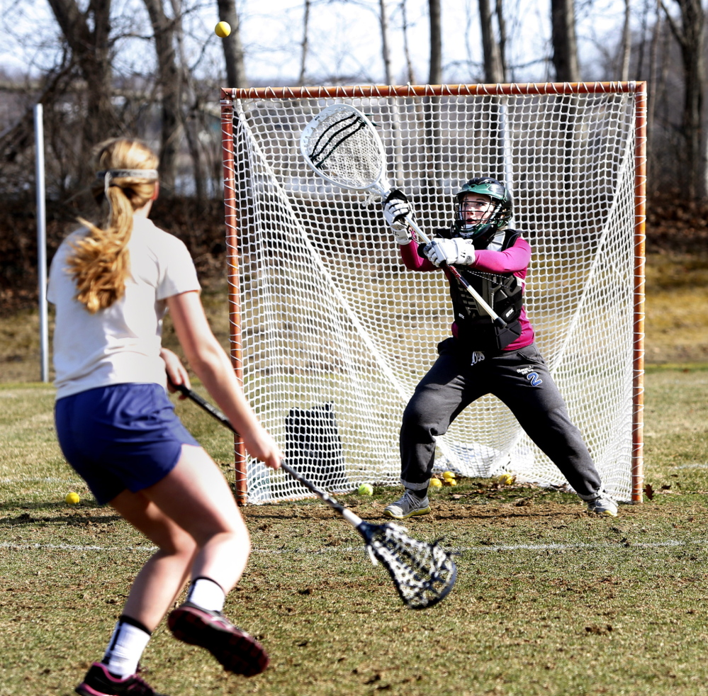 A former attacker, sophomore Charlotte Majcerik has shifted to goalie and will be counted upon to stop shots for perennial power Waynflete.