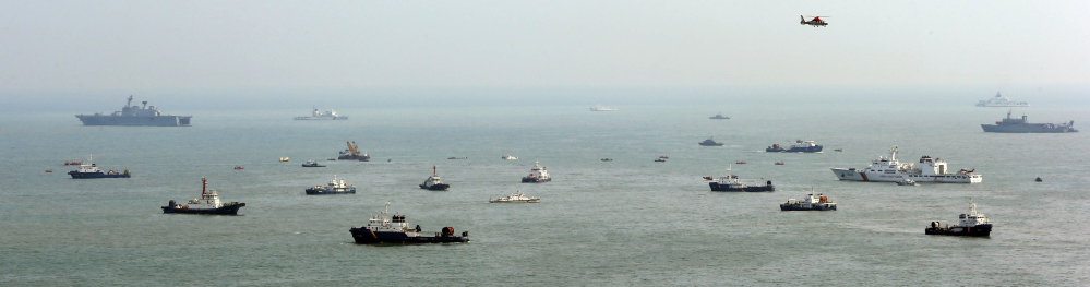Ships continue the search for passengers of the sunken ferry Sewol in the water off the southern coast near Jindo, South Korea, on Sunday.