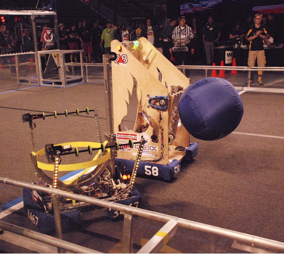 Windham Windup's robot works with the Riot Crew's robot.