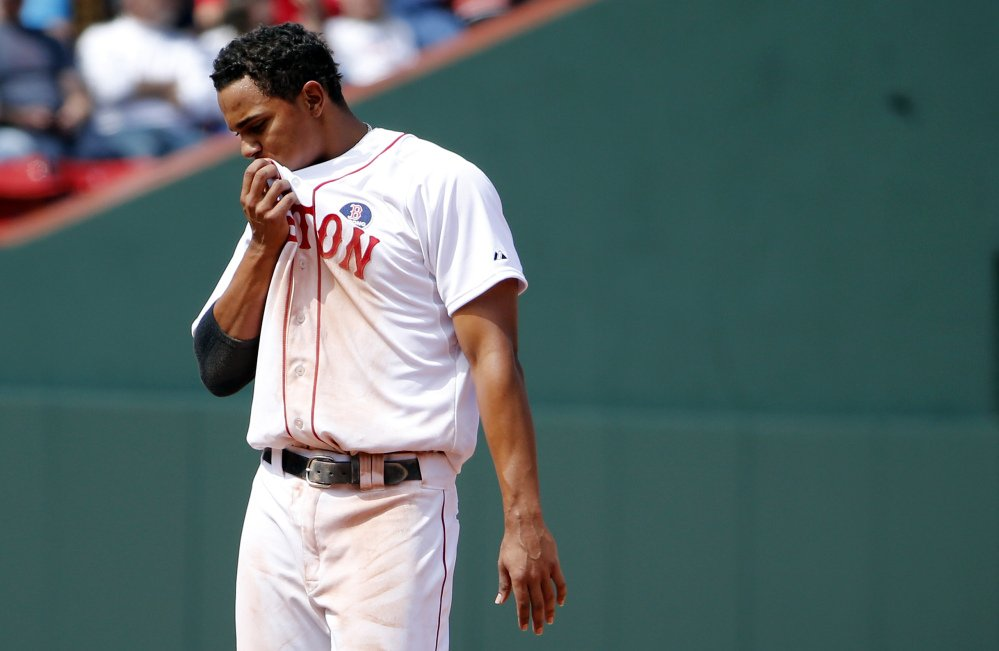 Red Sox's Xander Bogaerts pauses after being caught in a rundown to end the eighth inning during their 7-6 loss to the Orioles on Monday.