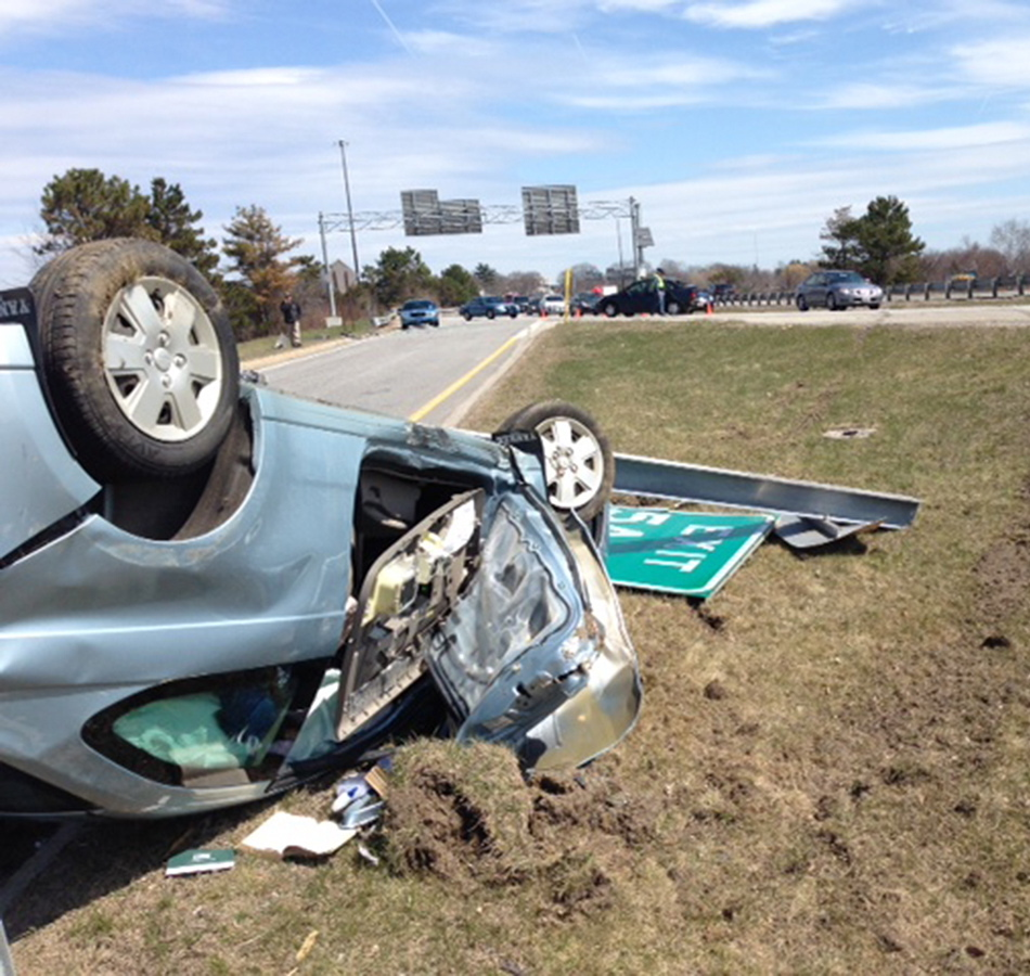 An overturned car is shown at the scene of a four-vehicle crash near Exit 5A on Interstate 295 in Portland on Monday.