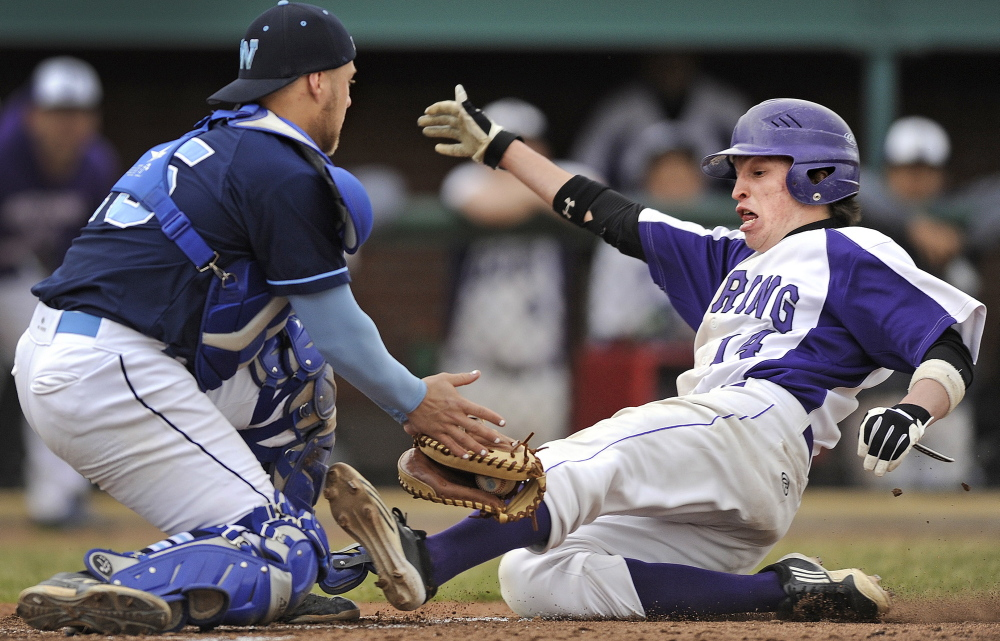 It's the play that made have decided the SMAA opener Tuesday. Westbrook catcher Kyle Heath slaps a tag on Ben Peterson of Deering, who, on a bases-loaded, no-out situation, trailing 2-0 in the fourth, attempted to score on a short fly to right. Didn't happen and Westbrook won, 5-1.