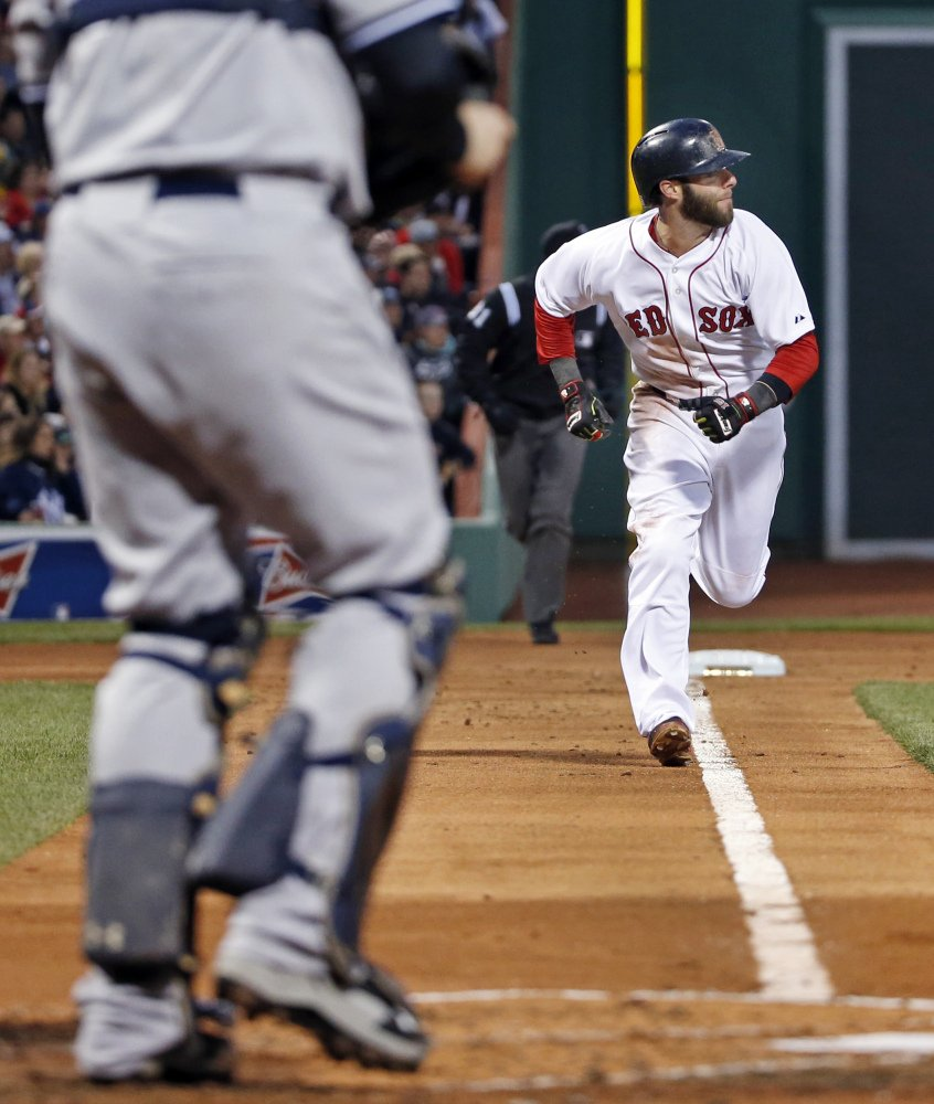 Red Sox second baseman Dustin Pedroia runs home to score on a single by A.J. Pierzynski in the first inning Wednesday.
