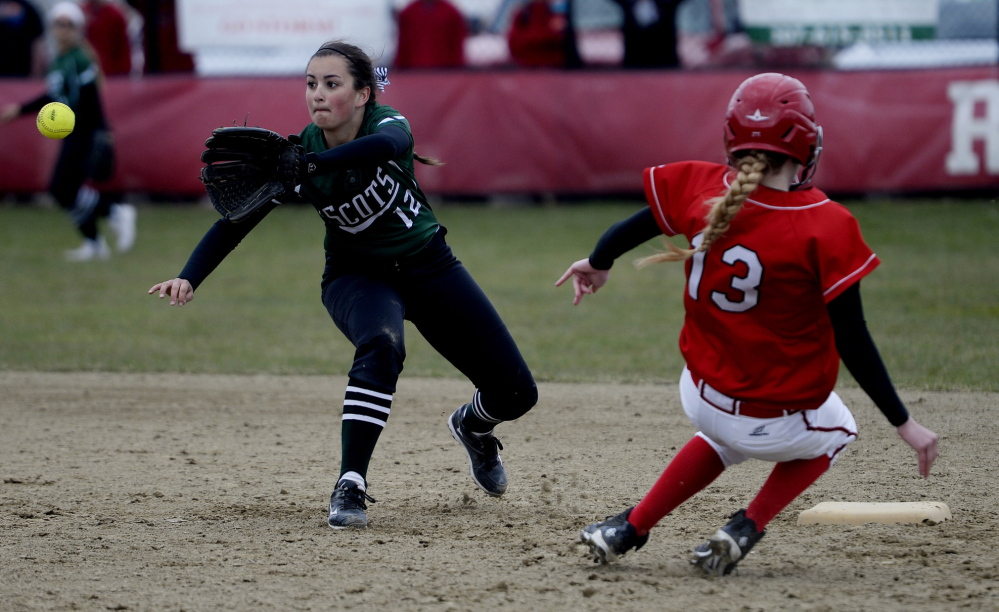 Bonny Eagle's Breanna Lifland waits for the ball as Scarborough's Brittany Plowman slides safely into second base for a stolen base during Wednesday's softball game.