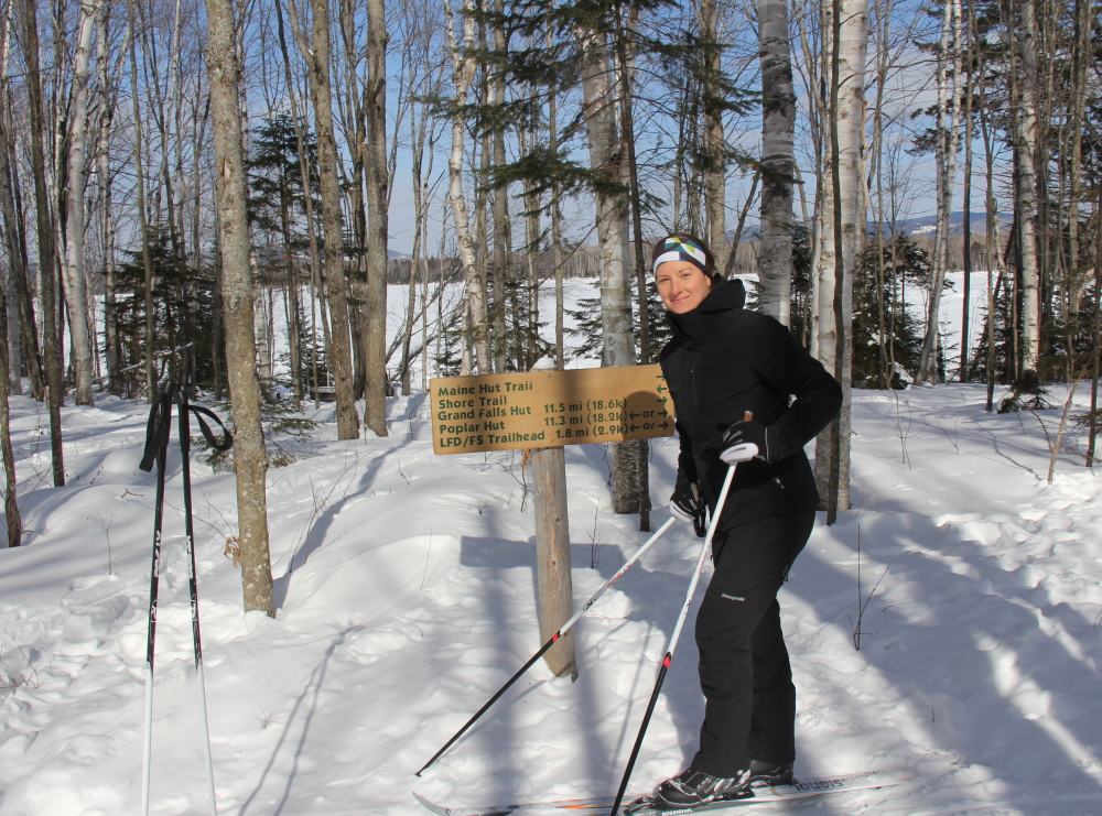 Sarah Pine, operations manager of Maine Huts & Trails, skis to work in winter and bikes in summer.
