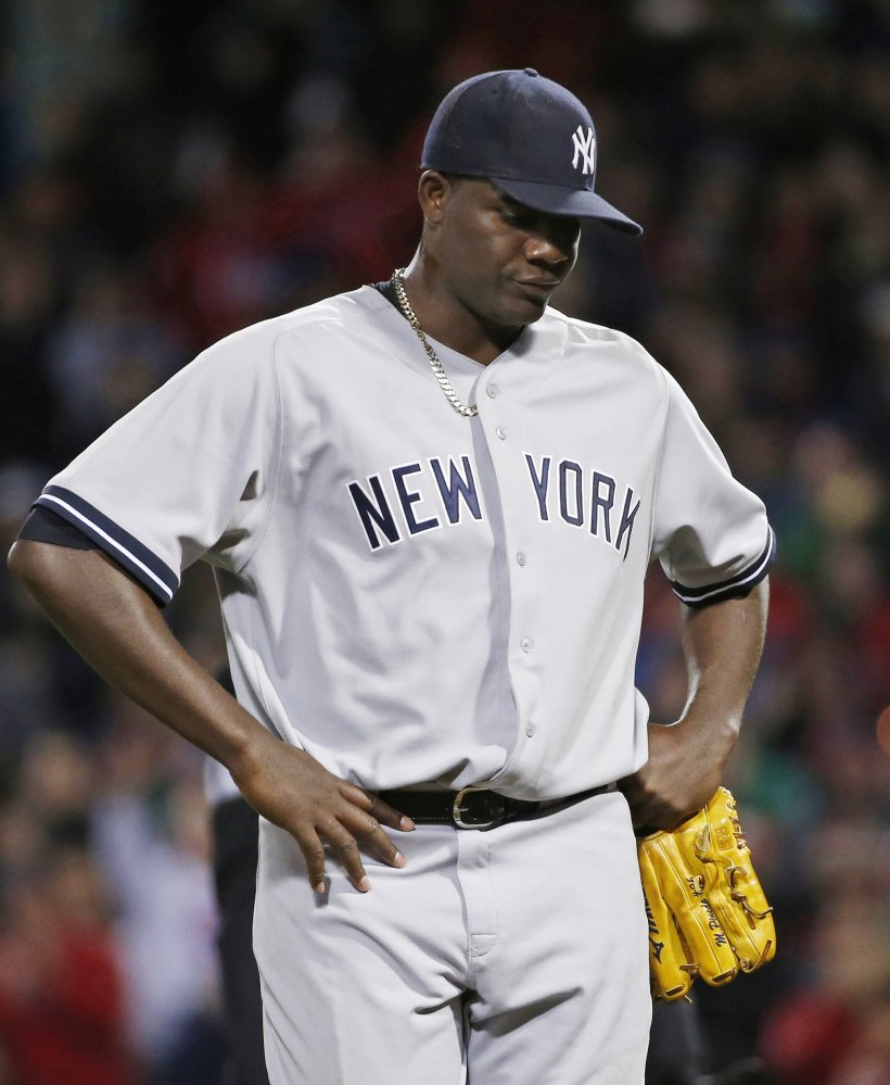 Yankees pitcher Michael Pineda walks off the mound after being ejected when pine tar was discovered on his neck Wednesday at Fenway.