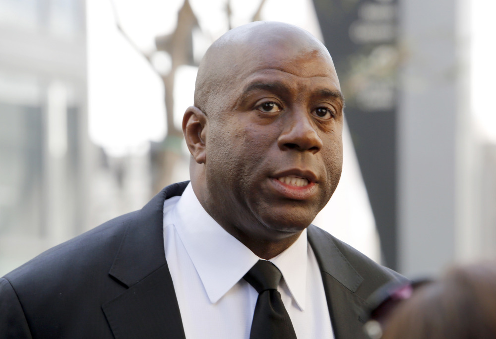 """Los Angeles Lakers player Earvin """"Magic"""" Johnson is calling upon NBA Commissioner Adam Silver to """"come down hard"""" on Los Angeles Clippers owner Donald Sterling."""