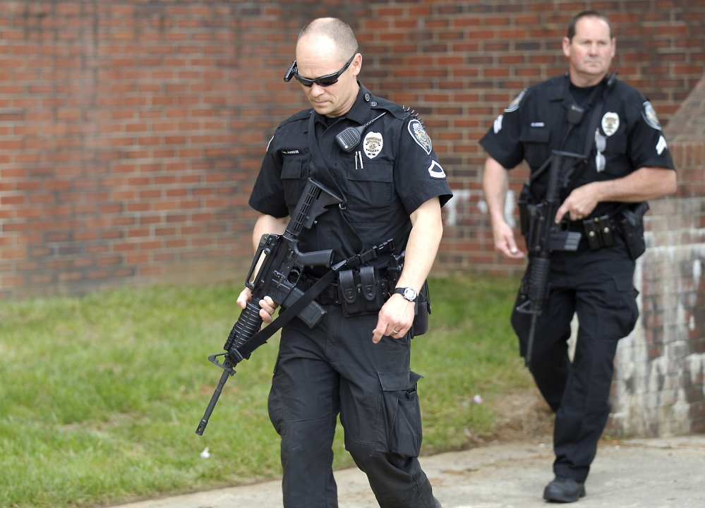 Greensboro police officers leave after after clearing Marteena Hall as North Carolina A&T State University locked down some buildings Monday while police searched for a man who was reported to be carrying a rifle on campus, in Greensboro, N.C. The lockdown was lifted after a search failed to find any sign of the reported gunman.
