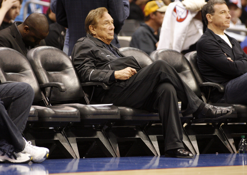 In this April 4, 2010, file photo, Los Angeles Clippers owner Donald Sterling sits courtside during the NBA basketball game between the New York Knicks and the in Los Angeles. NBA Commissioner Adam Silver Silver announced Tuesday, April 29, 2014, that Sterling has been banned for life by the league.