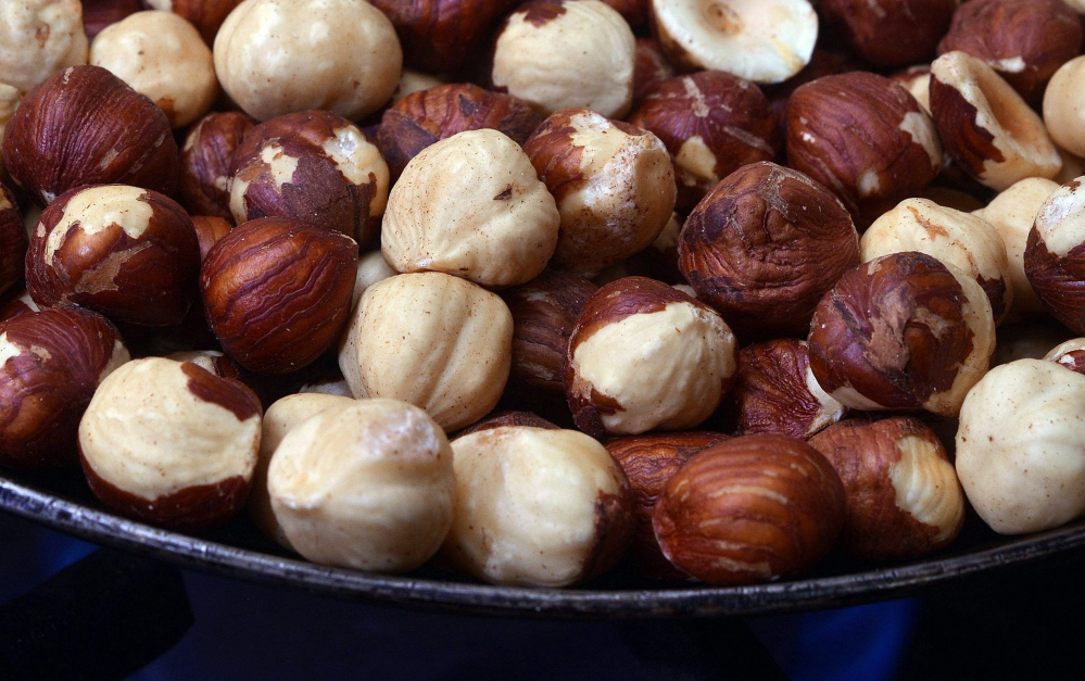 Oregon hazelnuts have become the global benchmark for large size and distinctive flavor. Here, hazelnuts toast in a pan.