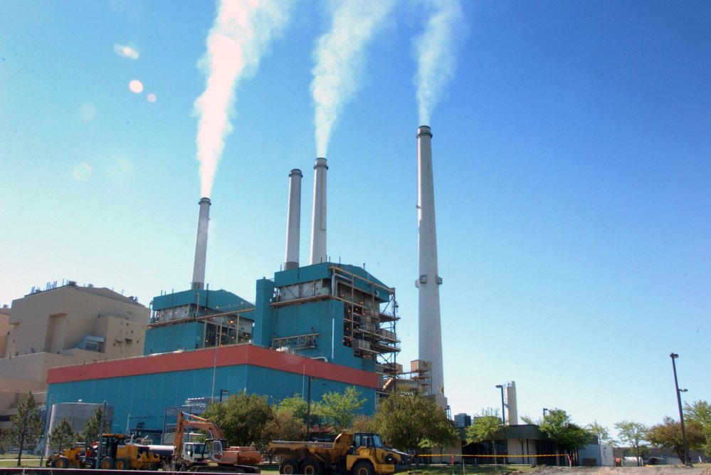 Smoke rises from the Colstrip Steam Electric Station, a coal-burning power plant in in Colstrip, Mont.