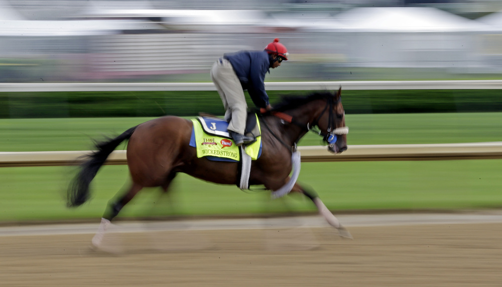 Exercise rider Kelvin Pahal takes Kentucky Derby hopeful Wicked Strong for a morning workout at Churchill Downs on Tuesday in Louisville, Ky.