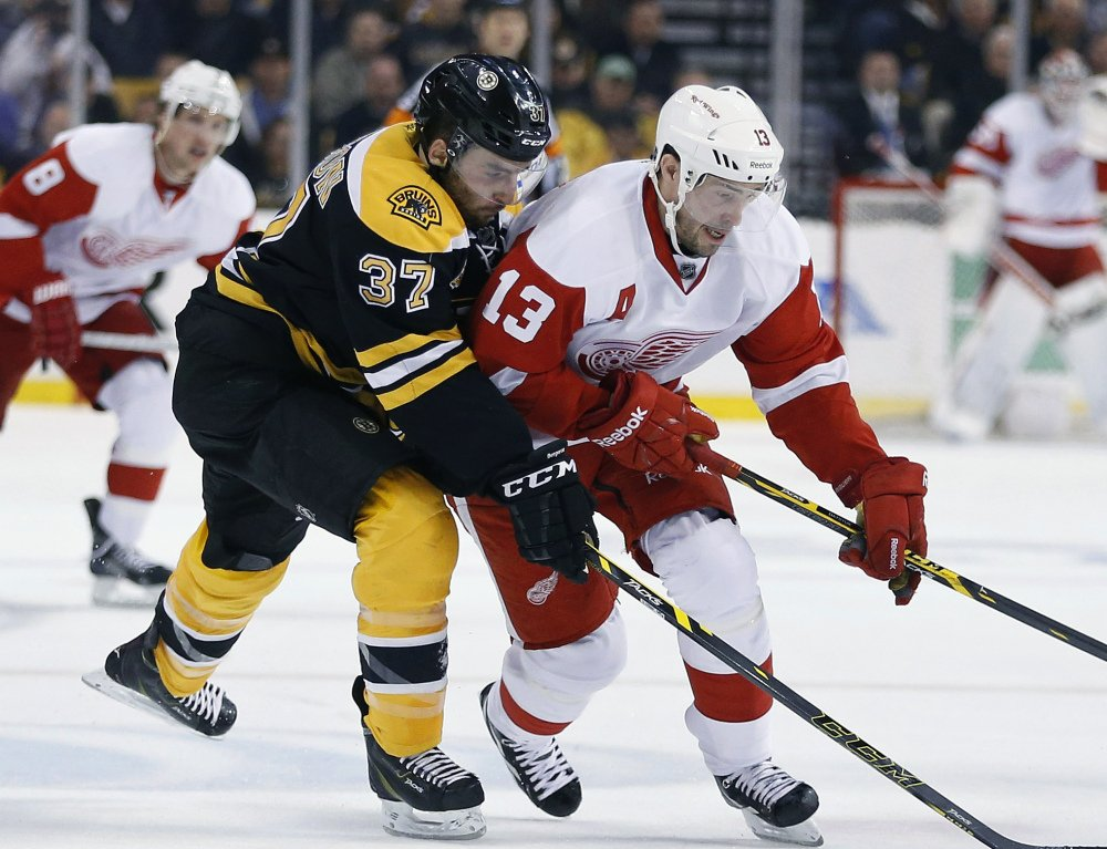 Boston's Patrice Bergeron, left, seen battling Detroit's Pavel Datsyuk during Game 5 of their first-round series, is one of the three award nominees who lead a stingy Bruins defense.