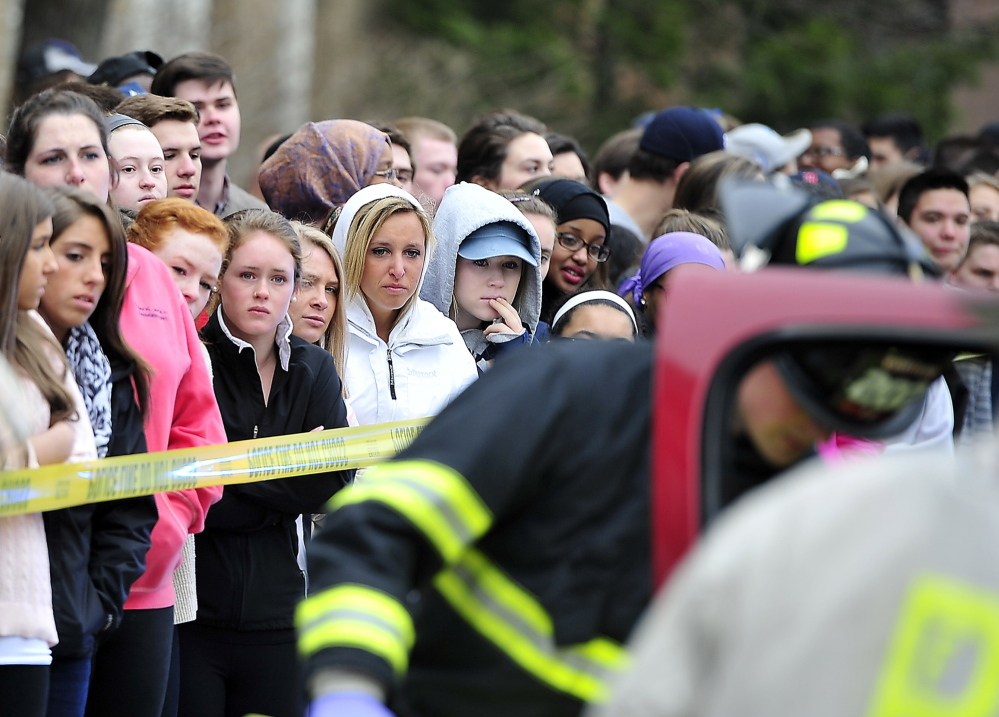Students react with somber expressions as Portland High School's Students Against Destructive Decisions sponsor a simulated accident to give students awareness about their behavior and driving habits. Participating in the simulation on Wednesday were the Portland Fire Department, Portland Police Department, Medcu and A.T. Hutchins Funeral Home as well as eight students from SADD who acted as the injured and deceased victims of the accident.