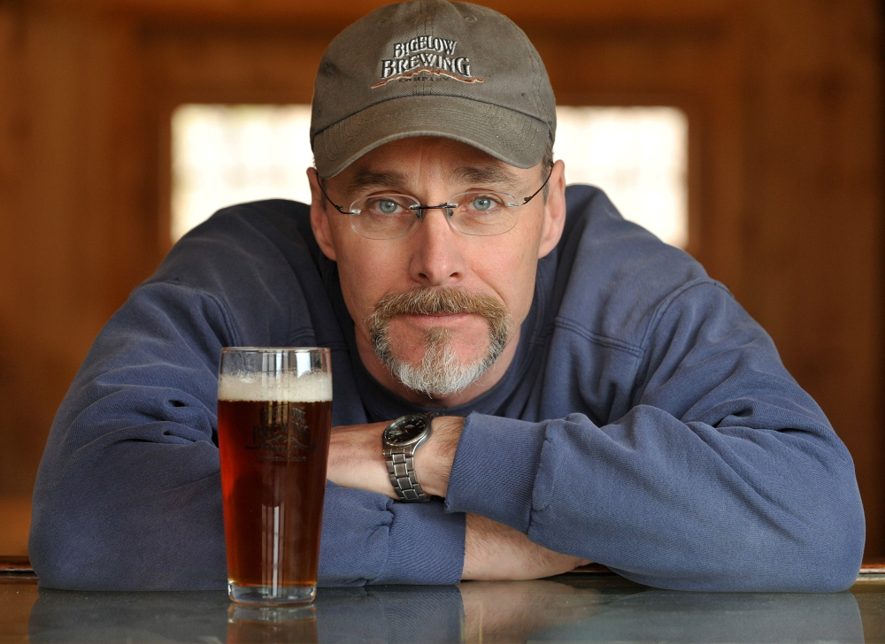 Brewer: Jeff Powers, owner of Bigelow Brewing Company, with his pale ale, Lying Bastard, in his brewery in Skowhegan on Tuesday. Bigelow Brewing Company has an open house on Saturday at the 473 Bigelow Hill Road location and will be offering free samples.