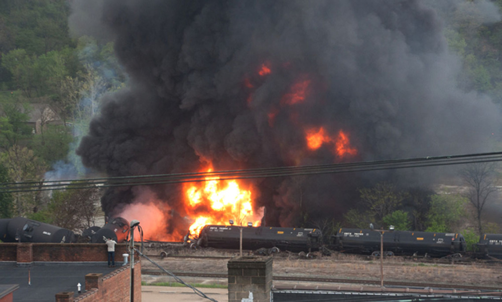 Several CSX tanker cars carrying crude oil burn after derailing in downtown Lynchburg, Va., on Wednesday.
