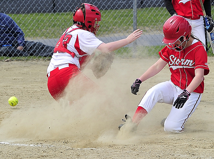 Chloe Gorey of Scarborough slides home safely as the ball gets past South Portland catcher Kiley Kennedy during Scarborough's 13-4 victory at home Friday. Gorey drove in three runs with two hits.