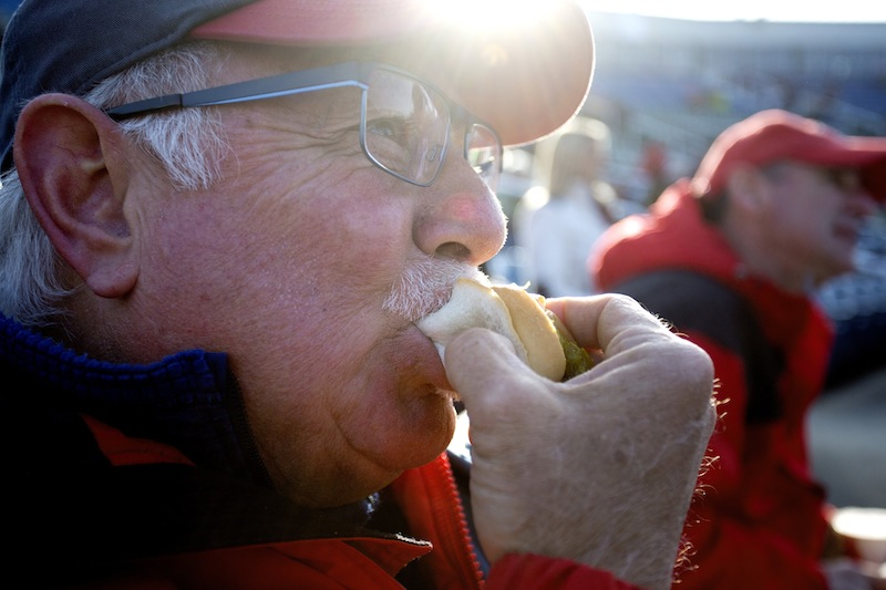 Ken Caprio of Scarborough bites into a hot dog before the start of the Portland Sea Dogs season opener at Hadlock Field. Caprio has owned season tickets since the Sea Dogs franchise started in 1994.