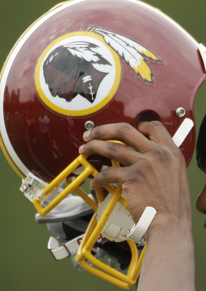 The Washington Redskins' owner says his team's name is 'not an issue,' despite critics' claims that it's insensitive to Native Americans.