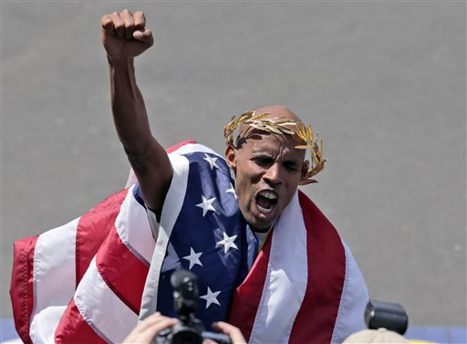 Meb Keflezighi of San Diego, Calif., celebrates his victory in the 118th Boston Marathon on Monday in Boston.
