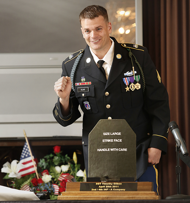 Sgt. Tim Gilboe of Jackman speaks at VFW Post 6859 Friday after being presented with a breastplate that saved his life during a fire fight in Afghanistan in 2011.