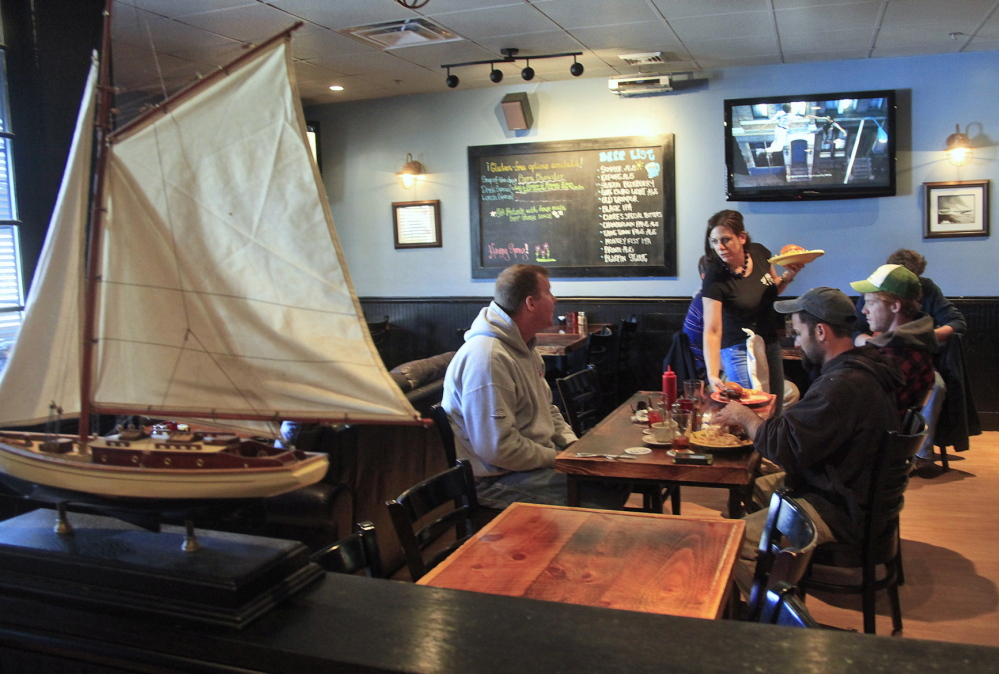 Melissa O'Leary of Eliot serves lunch to customers at the Shipyard Brew Pub. Though located in an unremarkable strip mall, the Eliot pub is remarkable for its friendly atmosphere and picky-eater-pleasing clam chowder.