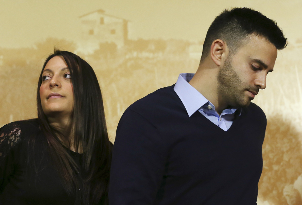 Meredith Kercher's sister Stephanie and brother Lyle arrive for a news conference Jan. 31 in Florence, Italy. Rarely has the family discussed the case in the public eye.