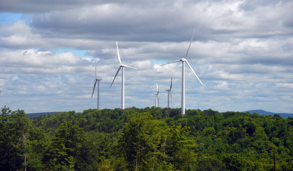 First Wind turbines spin on Stetson Mountain in Maine. The company has closed on financing for its sixth wind power project in Maine.