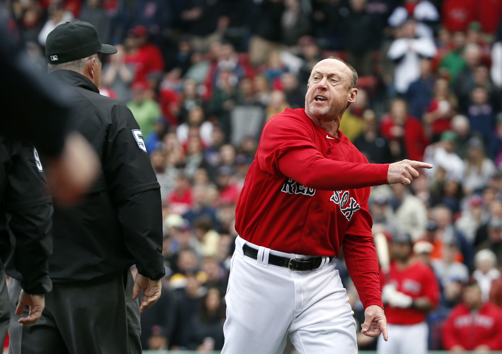 Boston Red Sox third base coach Brian Butterfield argues with umpires after they called Red Sox second baseman Dustin Pedroia out at home plate trying to score on a double by David Ortiz in the seventh inning in the first game of a doubleheader against the Tampa Bay Rays on Thursday.