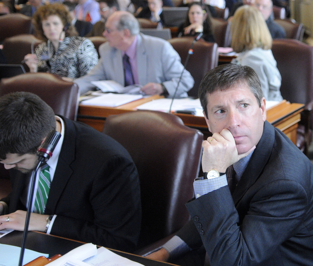 Andy Molloy/Kennebec Journal House Minority Leader Kenneth Fredette, R-Newport, watches members of the House vote on Thursday in Augusta to overturn one of the bills vetoed by Gov. LePage.