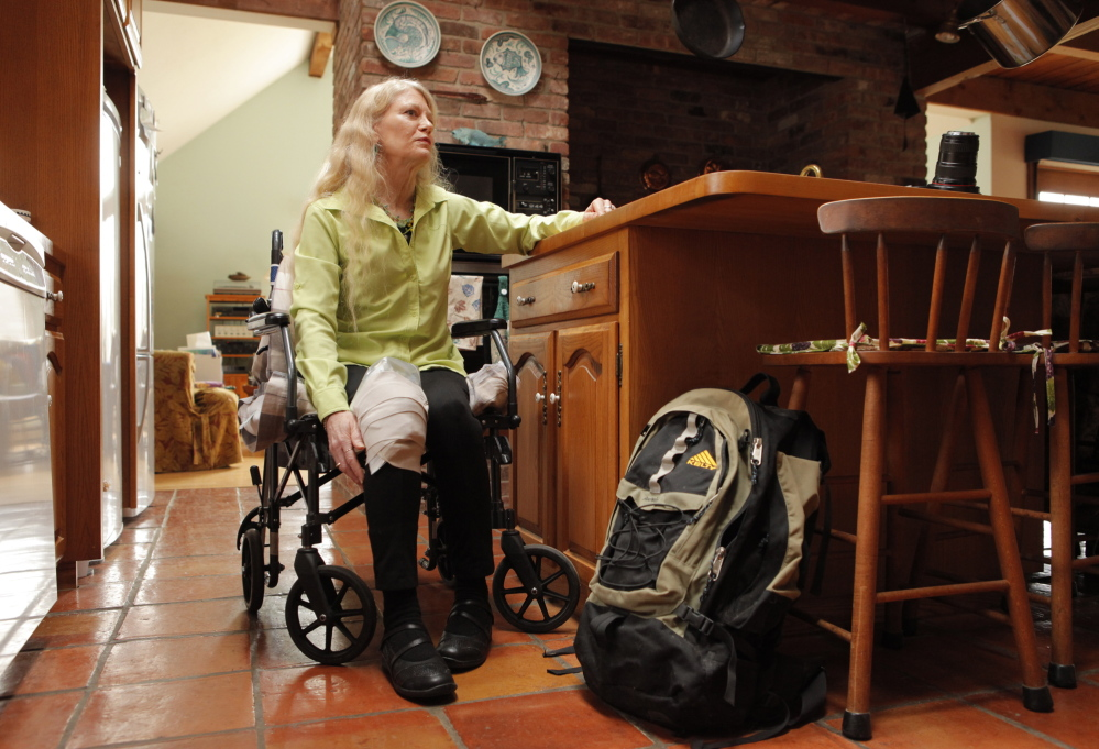 Eileen Whynot uses a wheelchair to get around her Gorham home on Tuesday, April 29, 2014 while she recovers from a ski accident that broke her pelvis. Whynot had to have surgery after the accident and is grateful to have health insurance through the Affordable Care Act.