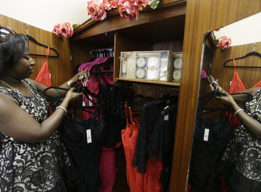 """Psyche Terry arranges her products at Indulge Your Senses boutique. """"It's definitely life changing. They really held my hand through the entire process,"""" she said of the Macy's program."""