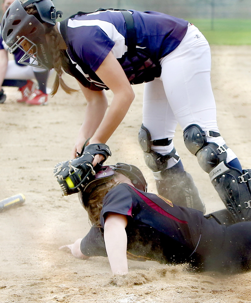 Cape Elizabeth's Michaela Pinette slides under the tag of Fryeburg catcher Mikayla Cooper to score a run in the fourth inning. Pinette scored two runs to help the Capers improve to 5-0.