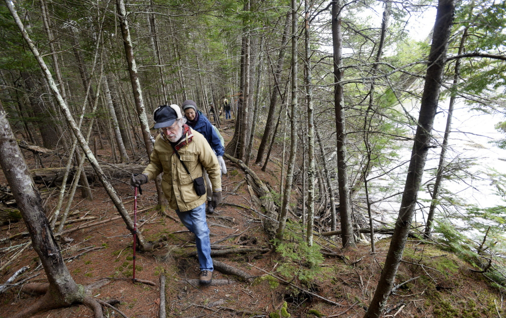 Jon Rosenthal of Damariscotta and other members of the Wednesday Walkers hike along the Great Salt Bay Heritage Trail in Newcastle on Wednesday. Founded more than 20 years ago, the group hikes weekly from May through October.