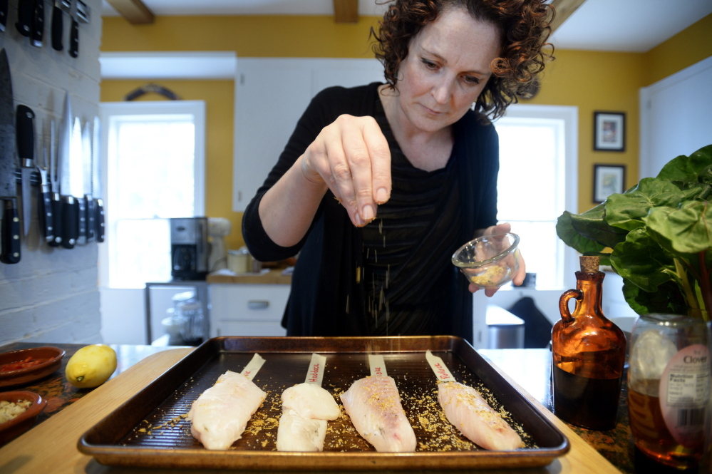 Rudalevige first seasons the fish with a mixtures of salt, pepper, lemon zest and cumin.