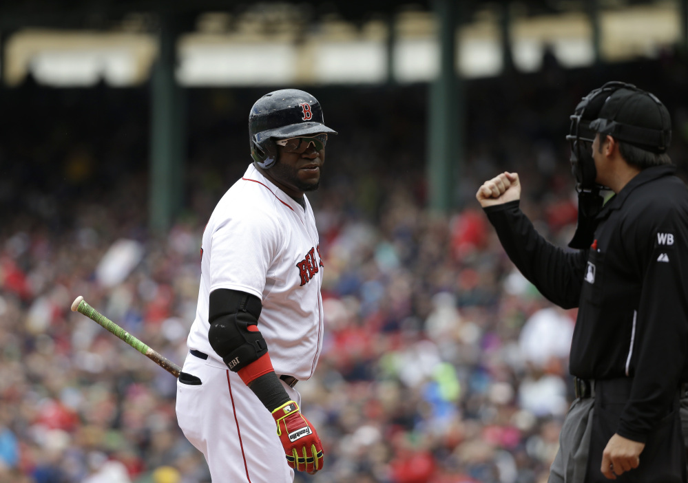 David Ortiz looks toward home plate umpire Mark Ripperger as he strikes out in the first inning Sunday against the Oakland Athletics.