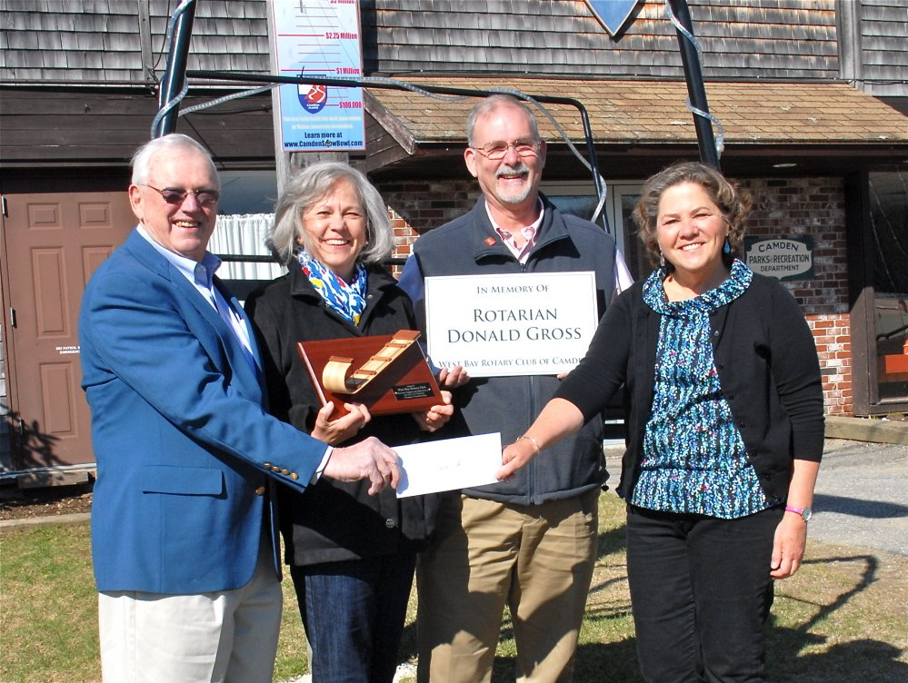 Ragged Mountain Recreation Area Foundation Capital Campaign co-chair Mort Strom, left, poses with Margie Gross, West Bay Rotary past president Sandy Cox and current West Bay president Jane Lafleur, right, as the group celebrates a $10,000 donation in the memory of Gross' late husband, Rotarian Donald Gross. The donation benefits the ski area.