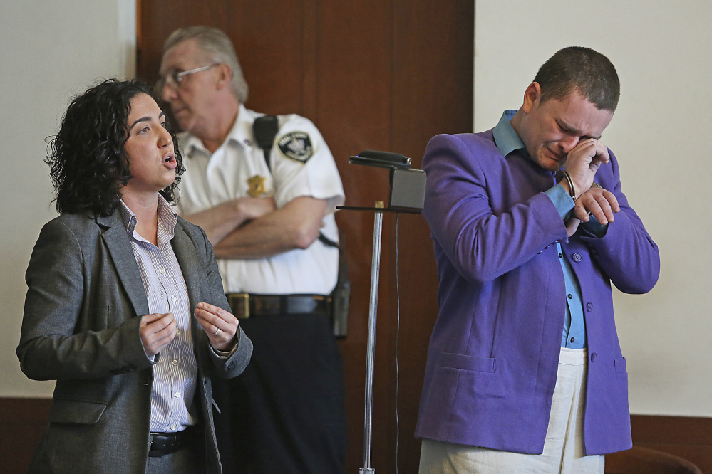 Kevin Edson cries during a hearing as he stands beside his attorney, Shannon Lopez, left, in Municipal Court Wednesday in Boston. Edson, accused of a bomb hoax near the Boston Marathon finish line on the anniversary of the 2013 bombing anniversary, was found mentally competent for trial after being evaluated at a state hospital following his April 15 arrest.