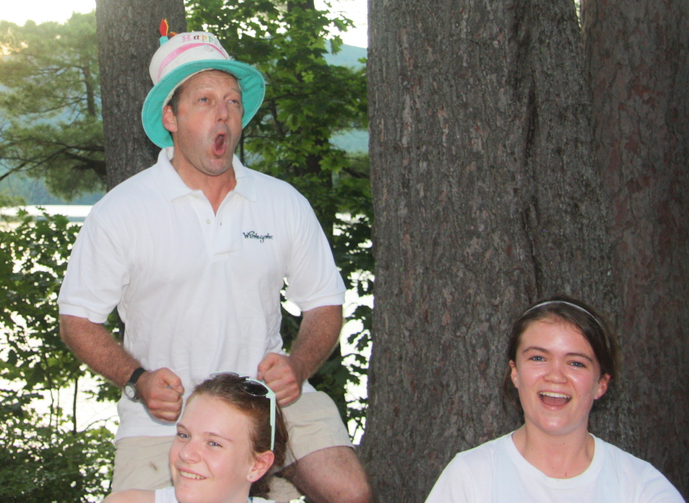 """Steven Sudduth, wearing a birthday hat, is the owner of Wyonegonic Camps in Denmark – where a week or more without a cellphone is part of the """"life skills"""" experience."""