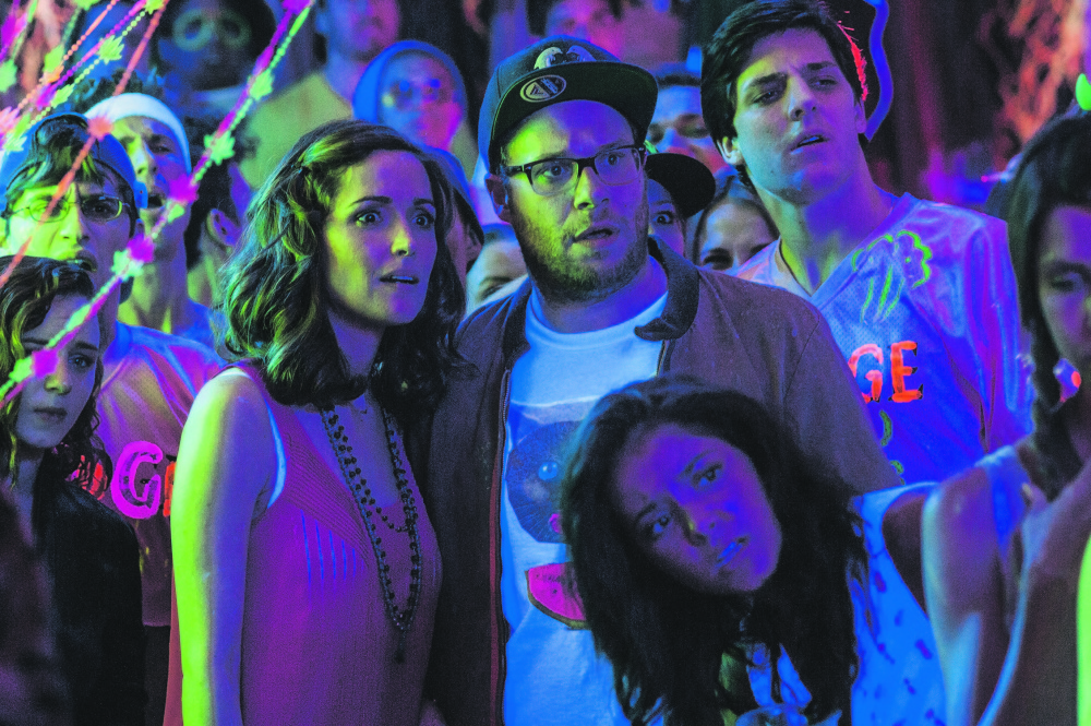 """Rose Byrne, left, and Seth Rogen are former partyers confronting their waning coolness in """"Neighbors."""""""