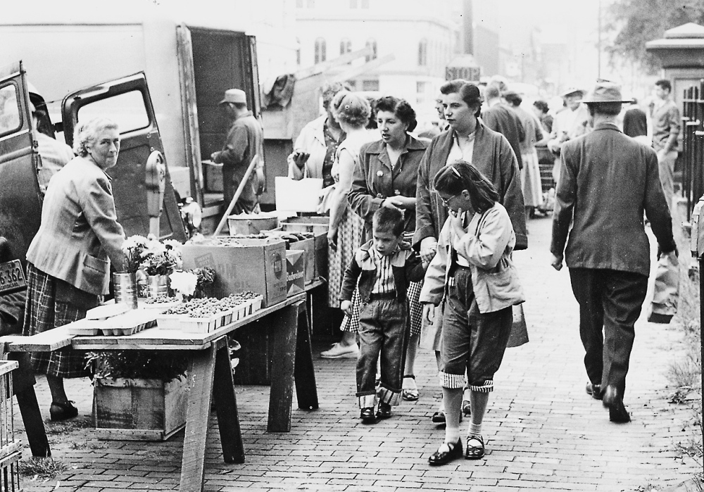 Shoppers in this 1956 file photo peruse farm fare outside Lincoln Park in Portland. Farmers markets declined with the advent of supermarkets and readymade food, but by the late '50s cooking authorities were making headway encouraging Americans to buy good ingredients.